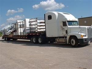 A freightliner loaded with goods.
